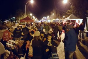 A crowded night time street during the Winter, Jasper in January Festival.
