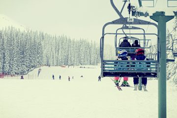 a family riding the chair lift at Marmot Basin in Jasper National Park