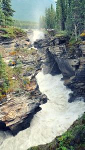 Deep canyon waterfall of Athabasca Falls in Jasper National Park