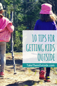 2 girls hiking on a forested path. text reads 10 tips for getting kids outside