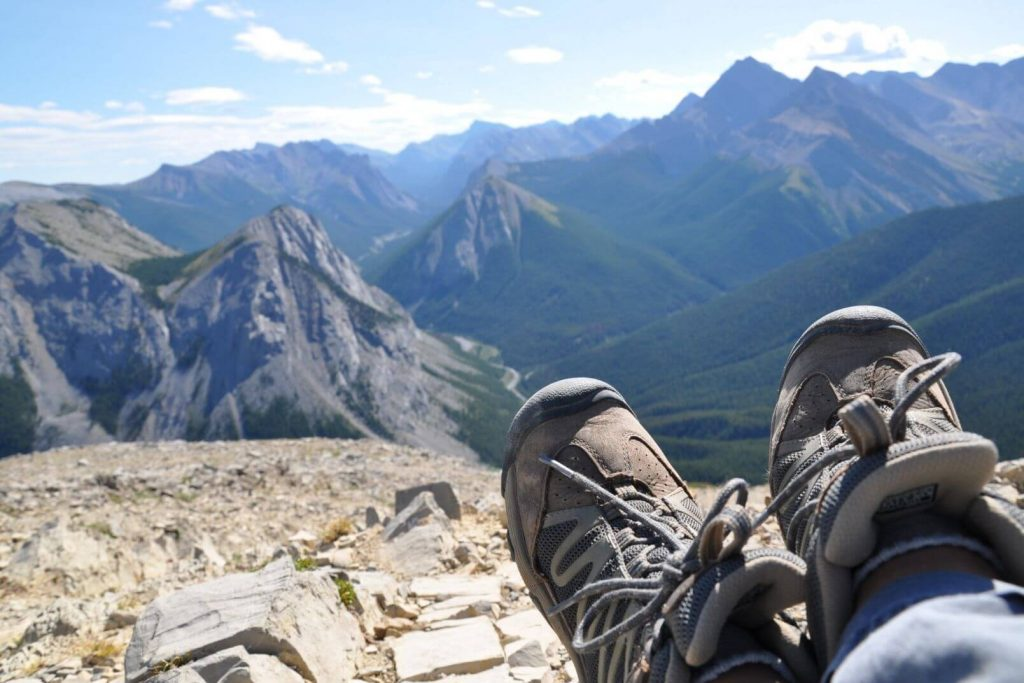 hiking shoes with the mountain view in the background