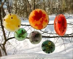 An easy winter craft are frozen ice sun catchers