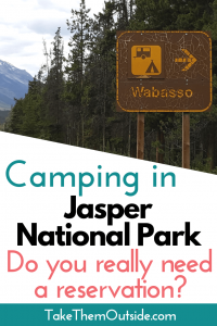 a road sign pointed to a campground. text reads camping in jasper national park, do you really need reservations?