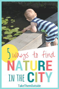 toddler leaning over a wooden rail looking down into a pond full of lilypads. text reads 5 ways to find nature in the city.