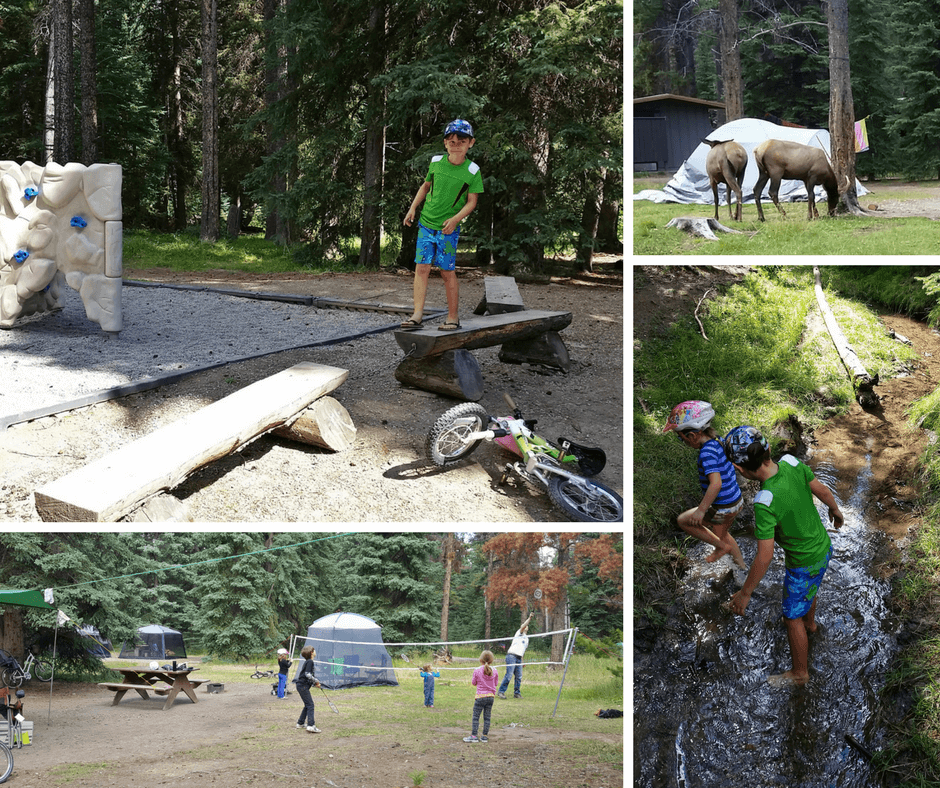 kids playing badminton, playing on wooden structures, and in a creek at Whistlers Campground in Jasper National Park
