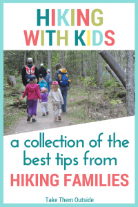 A large group of kids and parents on a wooded hiking trail, text reads hiking with kids a collection of the best tips from hiking families