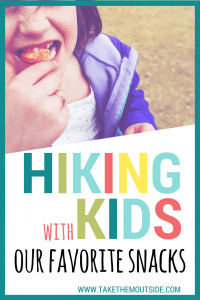 a young girl eating an orange, text reads hiking with kids our favorite snacks
