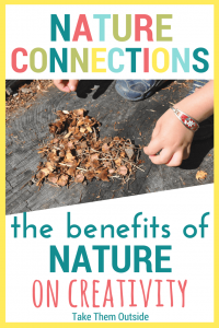 a small child's hands being creative outdoors by making a heart from pine cone pieces