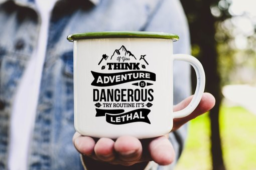 White enamel mug reads if you think adventure is dangerous then routine is lethal.