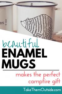 A bear illustration on a white enameled coffee mug