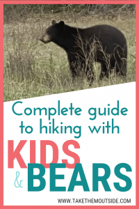 a black bear in the grass. text reads complete guide to hiking with kids and bears