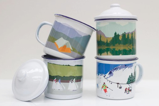 enamel mugs with scenes of outdoor activity printed on them