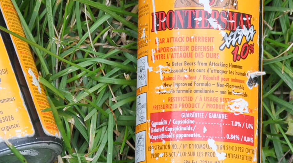 close up image of the label on a can of bear spray
