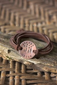 a wander often handmade bracelet with leather straps that an adventurer would love to wear