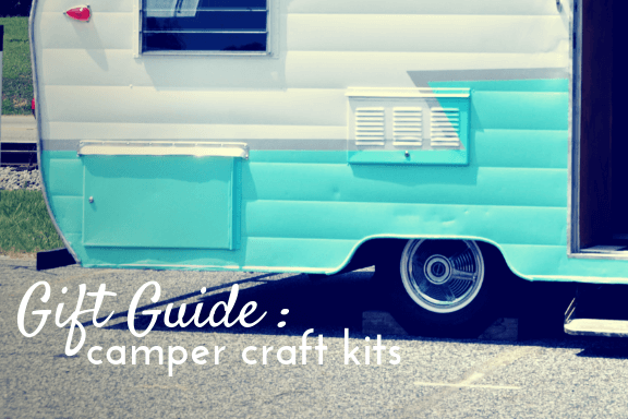 Back end of an aqua and white vintage camper, text reads gift guide camper craft kits