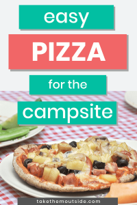 camping pizza on a picnic table at the campground