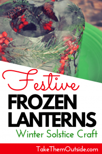 berries and pine leaves frozen into an ice lantern mold