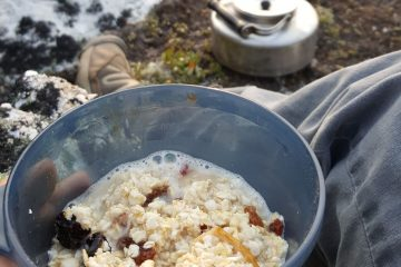 a cup of homemade instant oatmeal out camping on the hiking trail