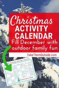 a snow covered tree, with an image of a printable outdoor activity holiday calendar