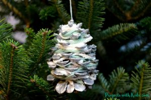 yarn wrapped pine cone ornaments