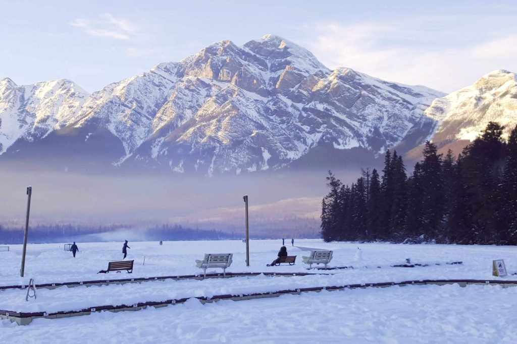 outdoor ice skating on the frozen lake at Pyramid Lake in Jasper National Park