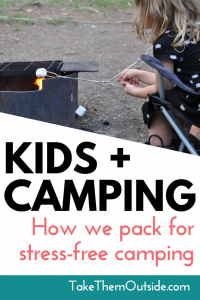 a child roasting a marshmallow over a campfire, text reads kids and camping- how we pack for family camping