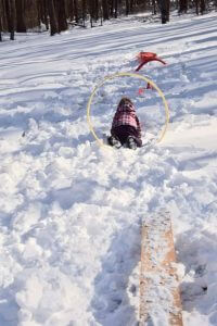 children playing in a snow obstacle course
