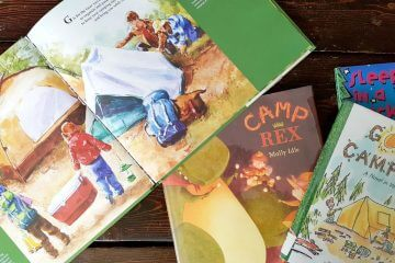a pile of kids books about camping