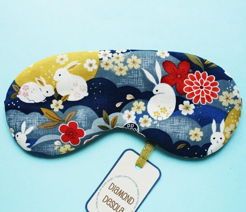 an eye mask with rabbits and flower pattern