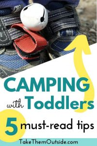 Toddler shoes with a bear bell attached to keep track of them at the campsite
