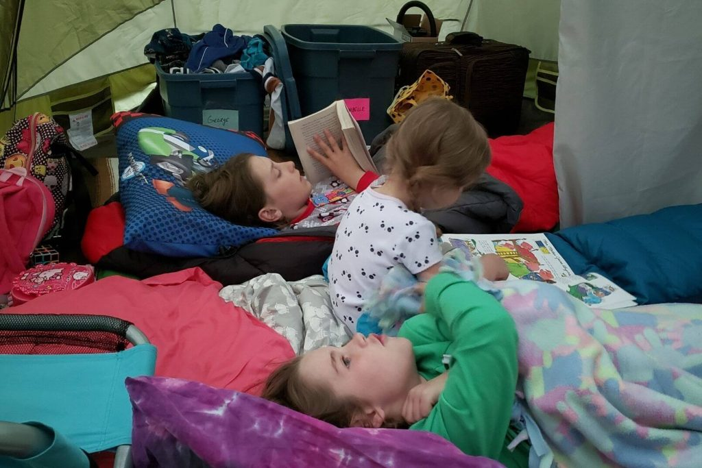 kids sleeping comfortably in a tent with regular pillows and bedding