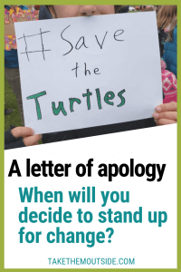 A child holding a climate protest sign which reads save the turtles