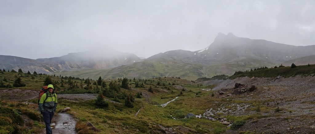 Hiking over Maccarib pass during a storm in Jasper National Park