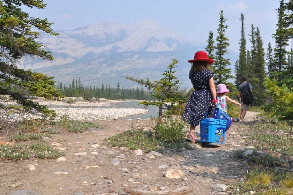 Children walking along the river path at Snaring Campground in Jasper National Park