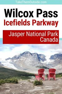 2 red parks chairs at the viewpoint overlooking the icefilelds in jasper national jark