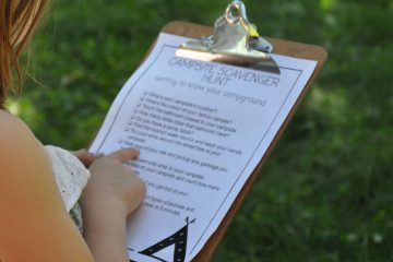 camping scavenger hunt on a clipboard
