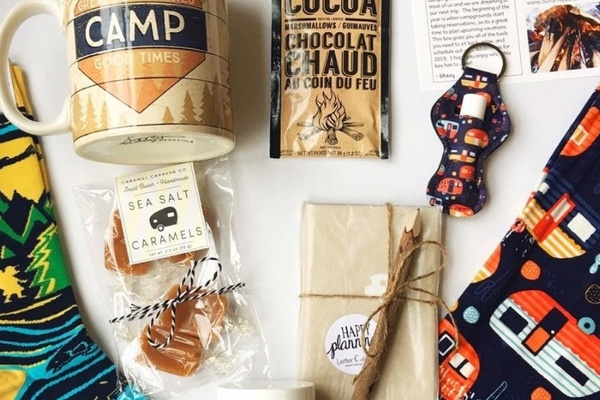 camper themed gifts and goodies, a mug, lip gloss holder, hot chocolate, and more