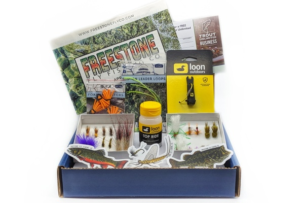 Fly fishing gear and supplies in a carboard box