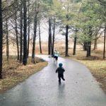 children running on a wet park path