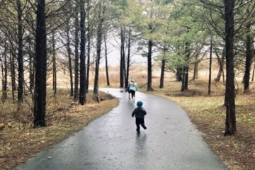 children running on a wet park path