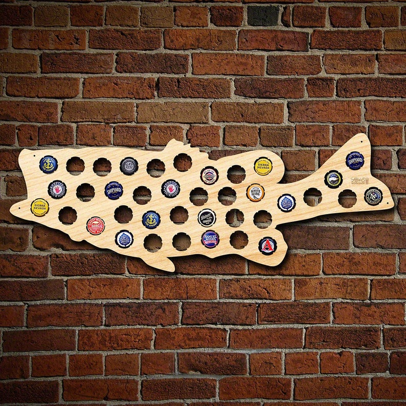 a wooden fish for holding bottle caps
