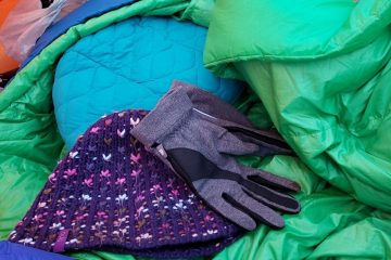 a toque, gloves, and down sleeping bag