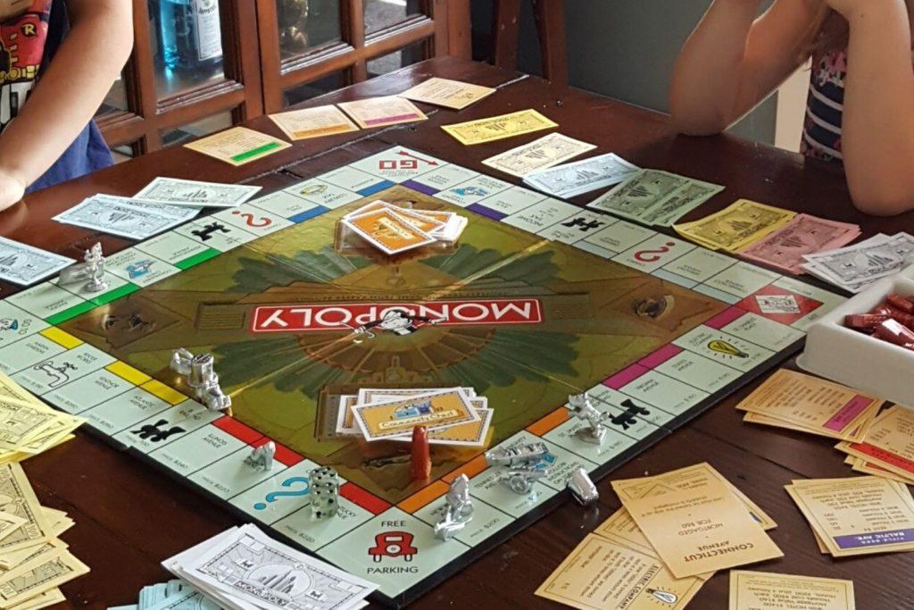 kids playing monopoly
