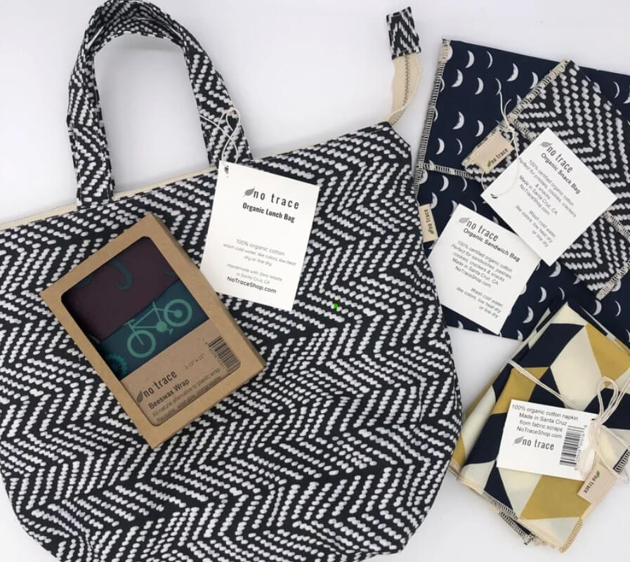 a handmade eco friendly lunch bag and reusable snack bags in matching greys and blacks