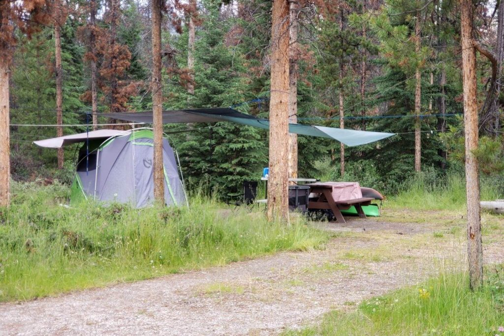 Large tarps hung over the campsite to help the tent and eating area stay dry
