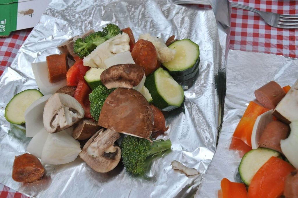 cut vegetables sitting on tin foil