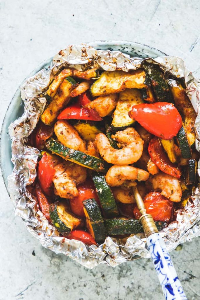 shrimp and zucchini cooked in a foil package