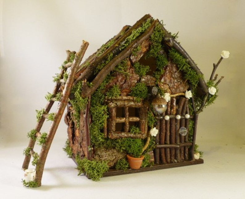 handmade fairy house from twigs and moss