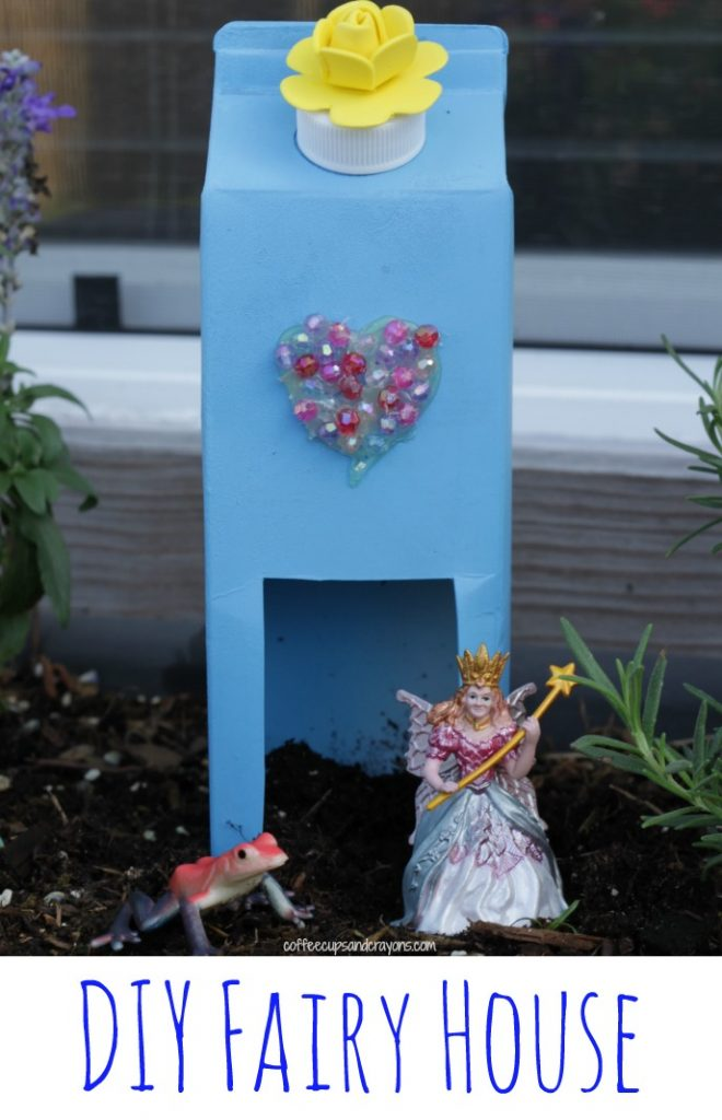 a blue fairy house made from a used milk carton