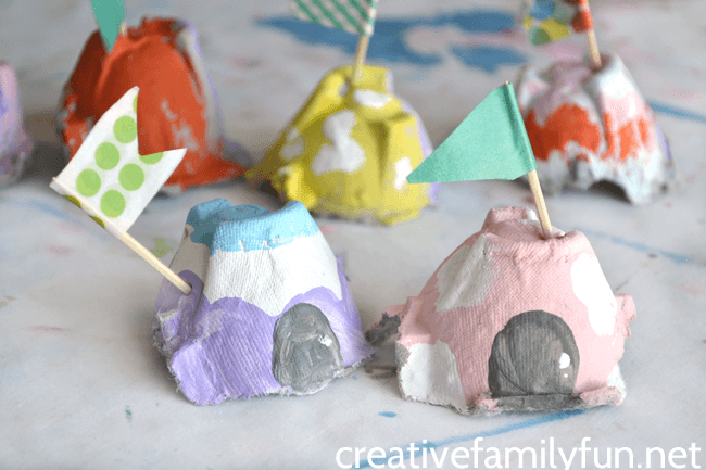 small pastel painted fairy houses made from egg cartons